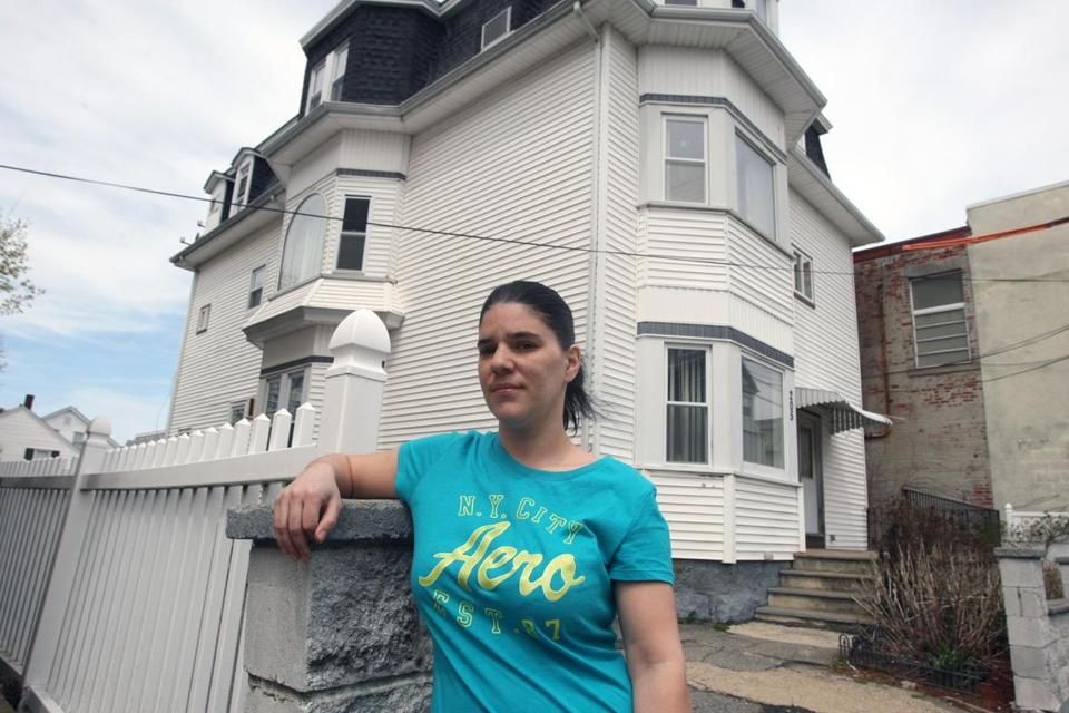 Residents in a three-family house were evacuated Friday in Fall River. Neighbor Rose Arruda spoke to reporters later.